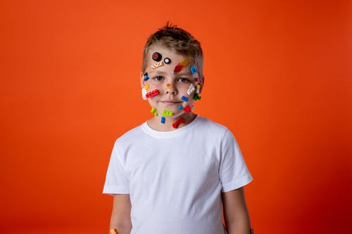 Boy in White Crew Neck T-shirt With Face Paint
