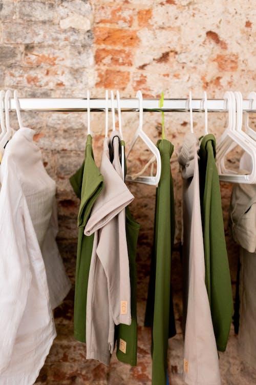 White Tank Top on Green Textile