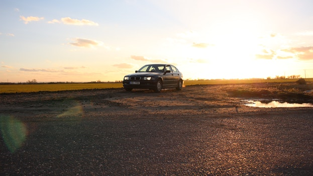 Free stock photo of sunset, car, vehicle, lens flare