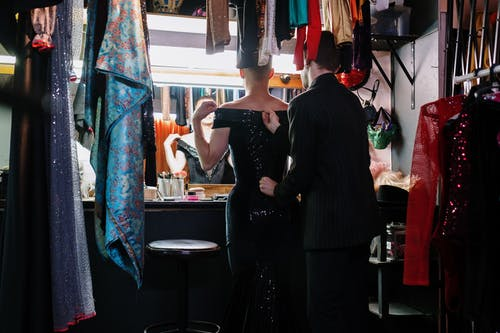Man Helping a Drag Queen with a Dress