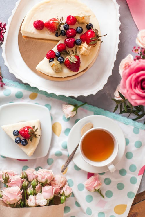 Appetizing cake and delicate bouquets of roses
