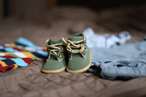 Baby's Green and Beige Sneakers on Brown Textile