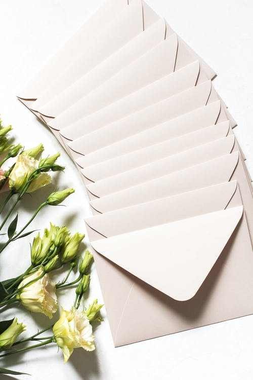Envelopes with bouquet of delicate flowers