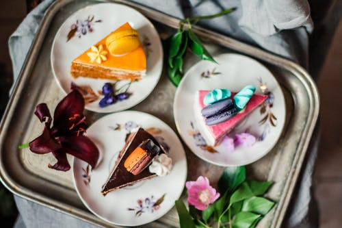 Colorful pieces of cakes with macarons