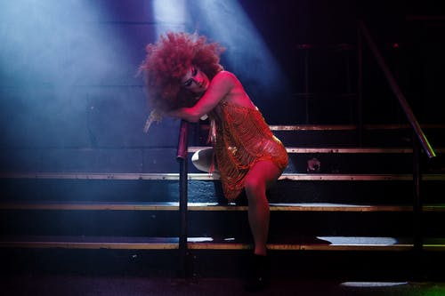 Drag Queen Leaning on a Handrail