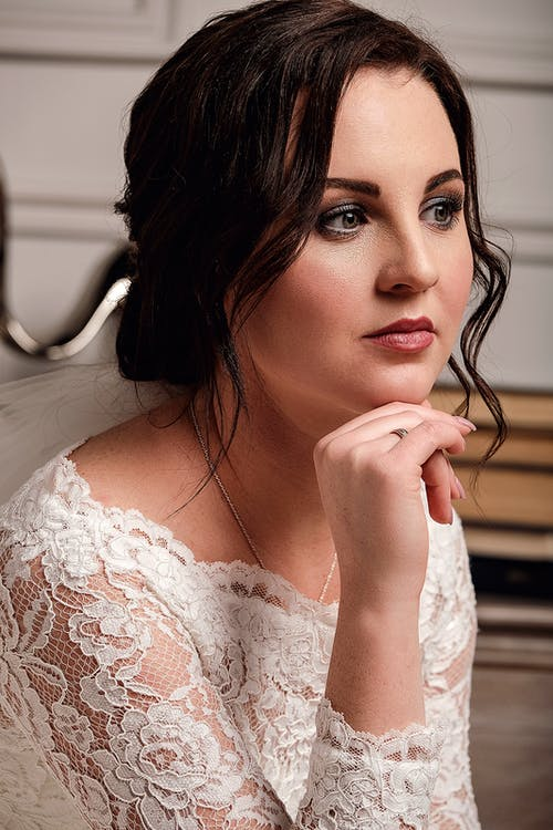 Romantic young bride waiting for wedding ceremony