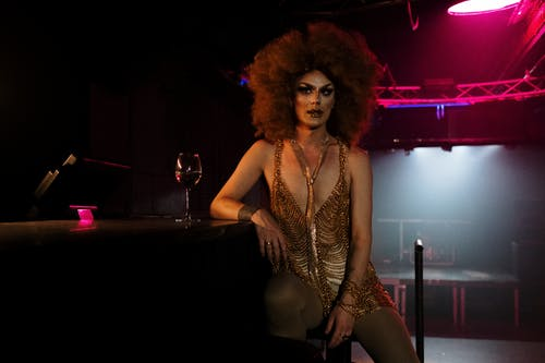 Drag Queen Sitting at a Bar