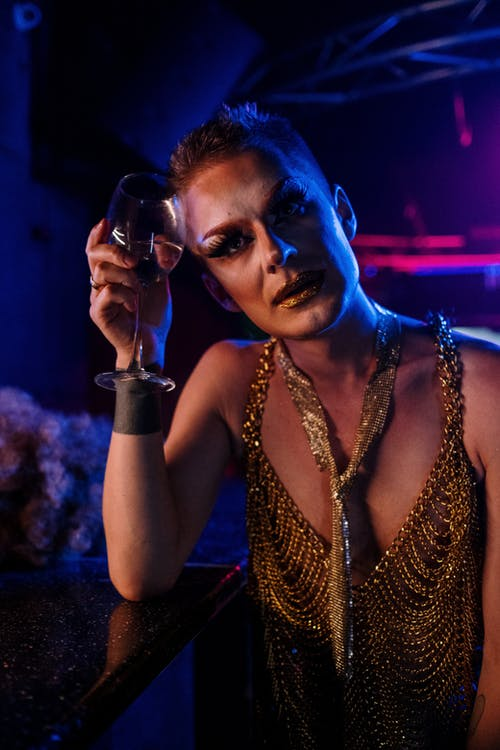 Drag Queen Holding a Wine Glass