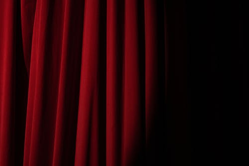 Spotlight on a Red Curtain