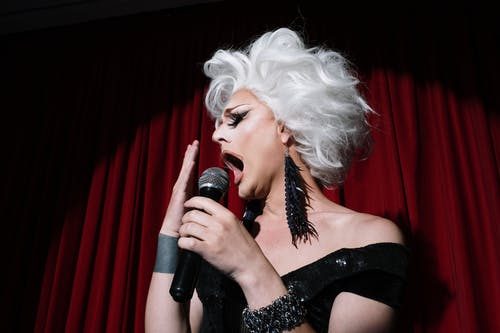 Drag Queen Singing on Stage