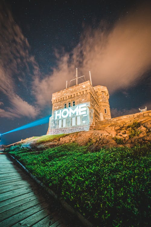 Laser projection of word Home of facade of medieval building