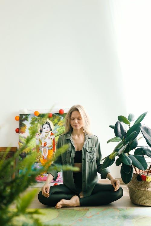 Woman in Black Blazer Standing Beside Green Plant
