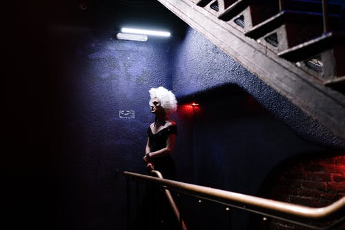 Drag Queen Waiting by Stairs
