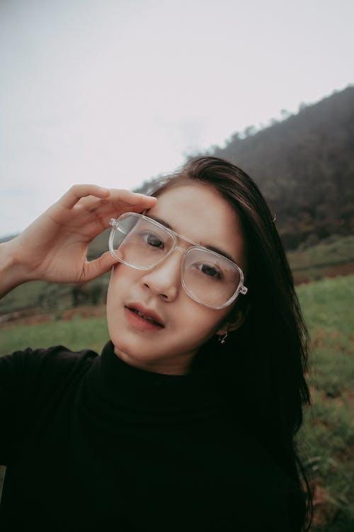 Woman in Black Crew Neck Shirt Wearing Eyeglasses Smiling