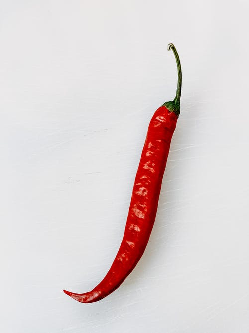 Red Chili Pepper on White Surface