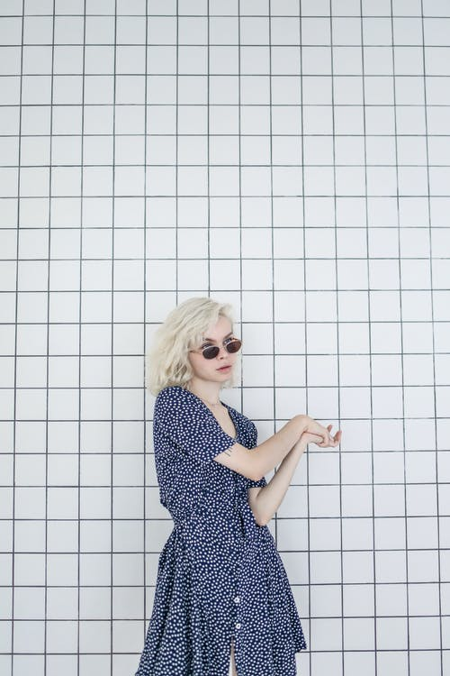 Photo of Girl in Blue Polka Dots Dress Wearing Sunglasses