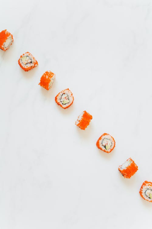 Orange and White Cookies on White Surface