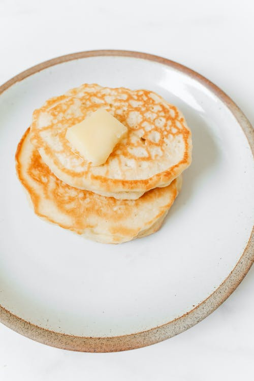 Photo of Pancakes With Butter on White Ceramic Plate