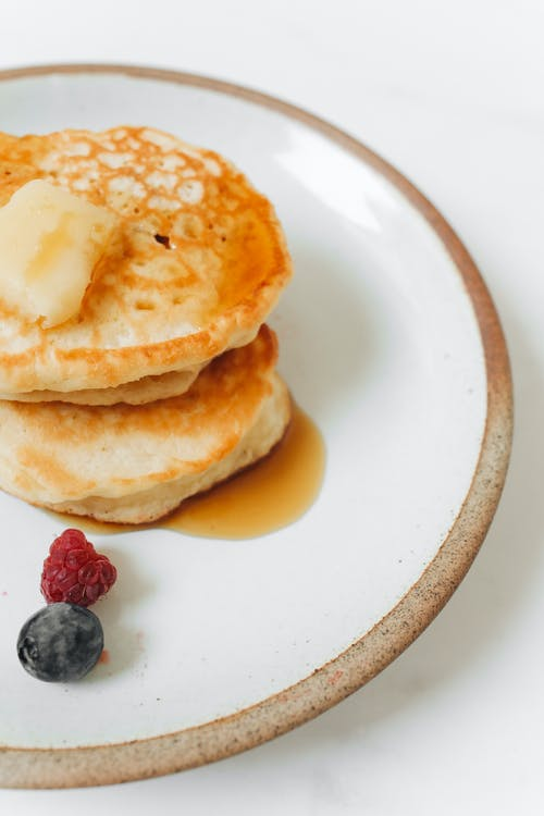 Pancakes With Red and Black Berries on White Ceramic Plate
