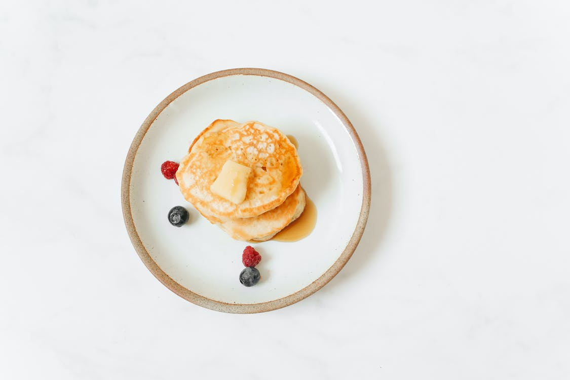 Pancakes With Red and Black Berries on White Ceramic Plate - Riddles for Students