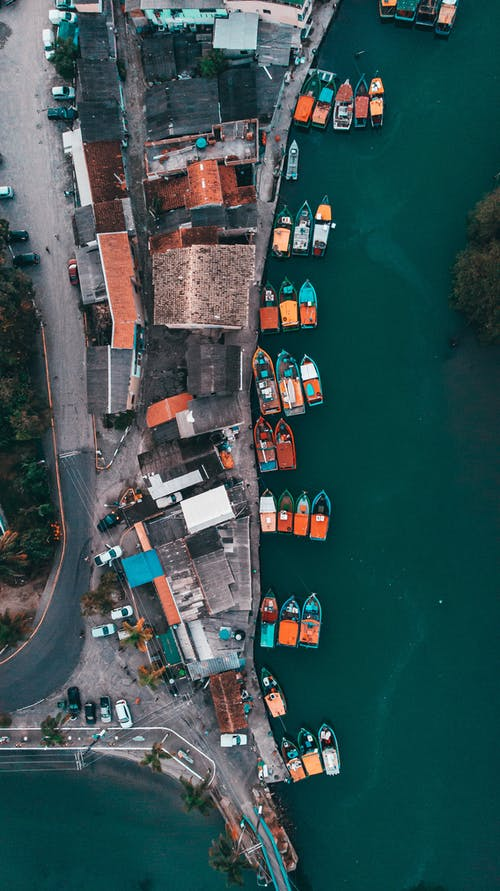 Boats moored on small town port