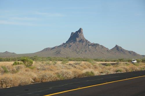 Clear sky over solitude mountain near automobile road