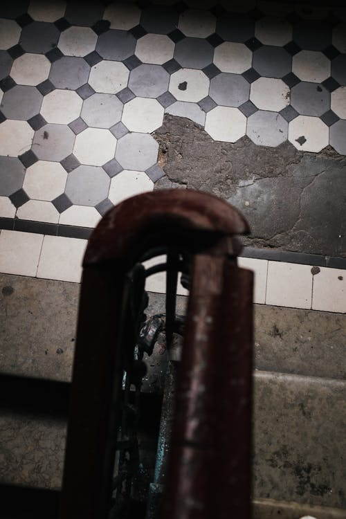 Brown Wooden Door on White and Gray Floor Tiles