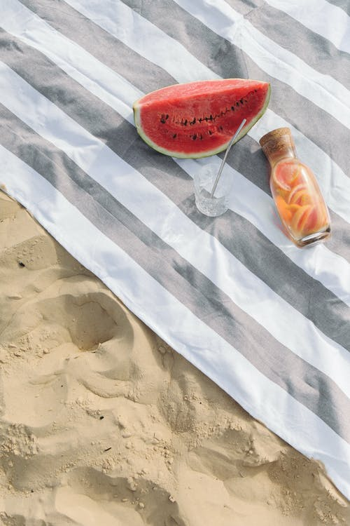 Sliced Watermelon on White and Gray Striped Textile