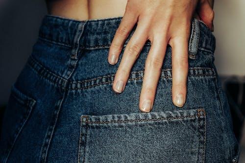 Person Wearing Blue Denim Bottoms