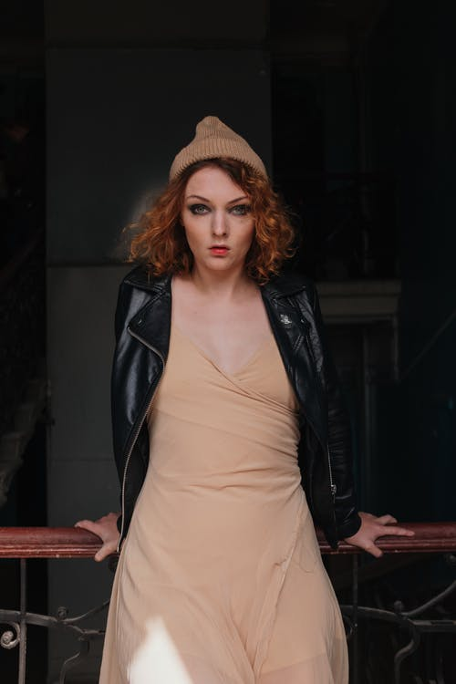 Woman in Black Leather Jacket and Brown Skirt