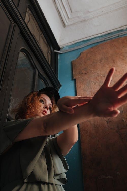 Woman in Black Coat Raising Her Right Hand