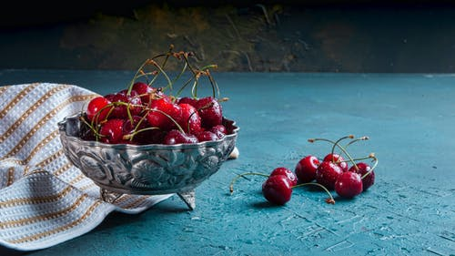 Red Cherries in Silver Bowl