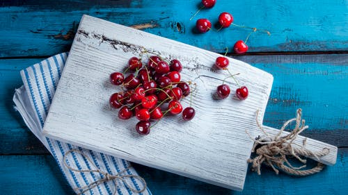 Red Cherries on Wooden Chopping Board