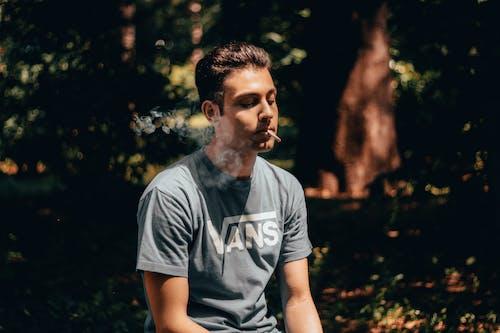 Man in Grey Crew Neck T-shirt Smoking