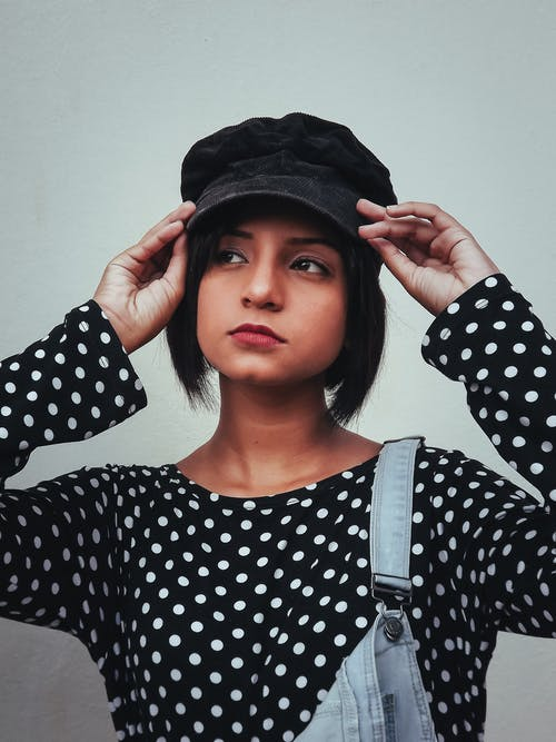 Woman in Black and White Polka Dot Long Sleeve Shirt
