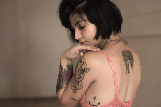 Woman With Anchor Tattoo in Pink Bra