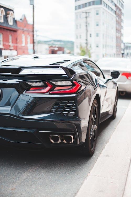 Stylish black car on city road