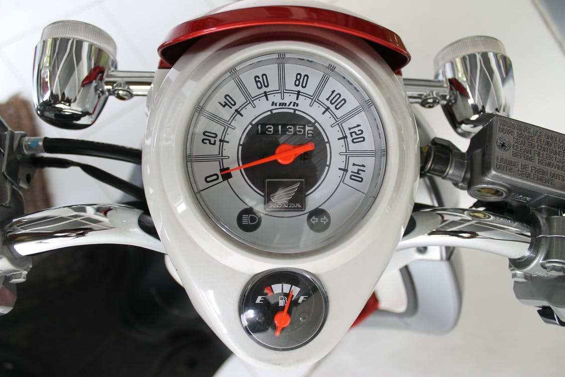 White and Red Motorcycle Gauge