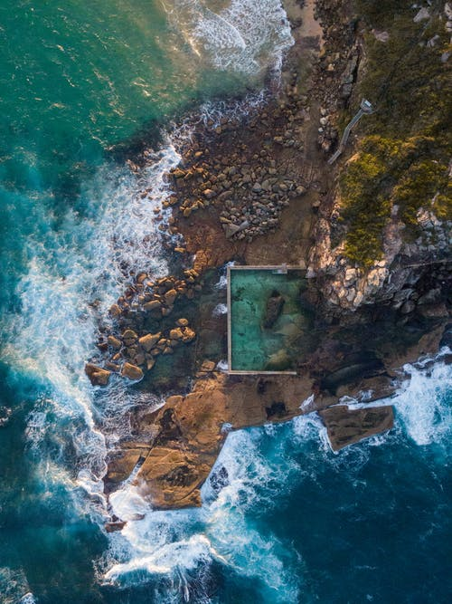 Aerial Footage of Waves Crashing on Rocky Shore