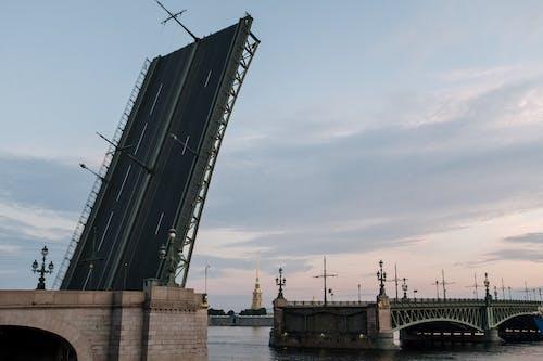 Black and White Steel Crane Near Body of Water