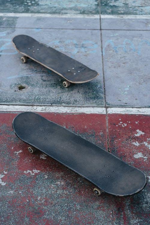 Black Skateboard on Gray Concrete Floor