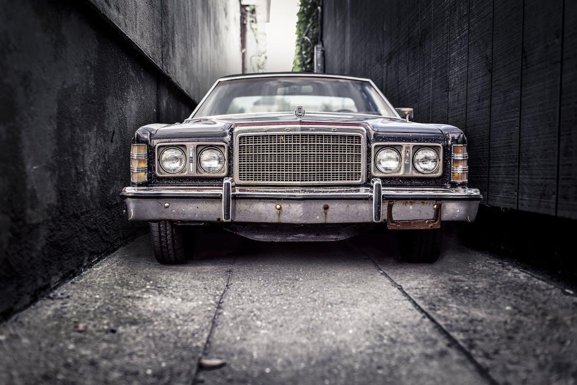 Gray Car on Narrow Road