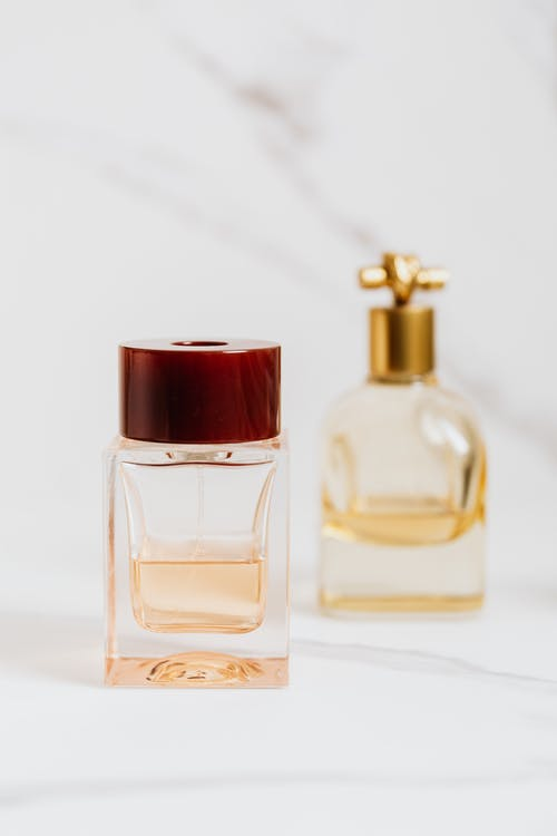 Clear Glass Perfume Bottle with Red Lid