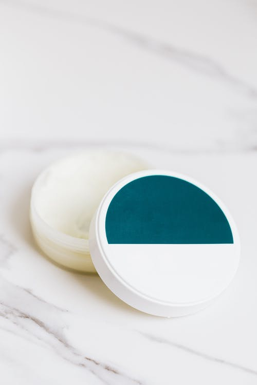 White Round  Container with White and Blue Cover