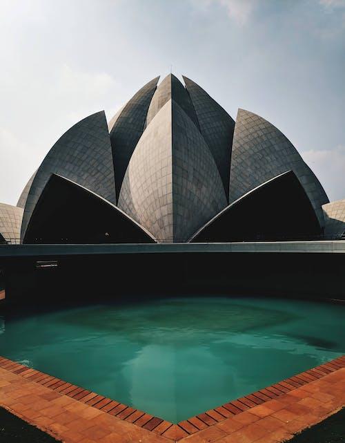 Modern geometric futuristic building near pool