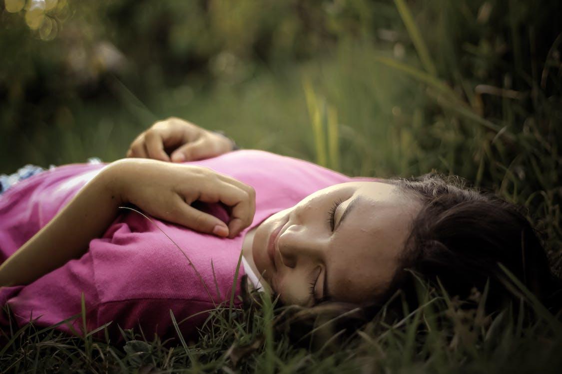 Woman Lying on Green Grass