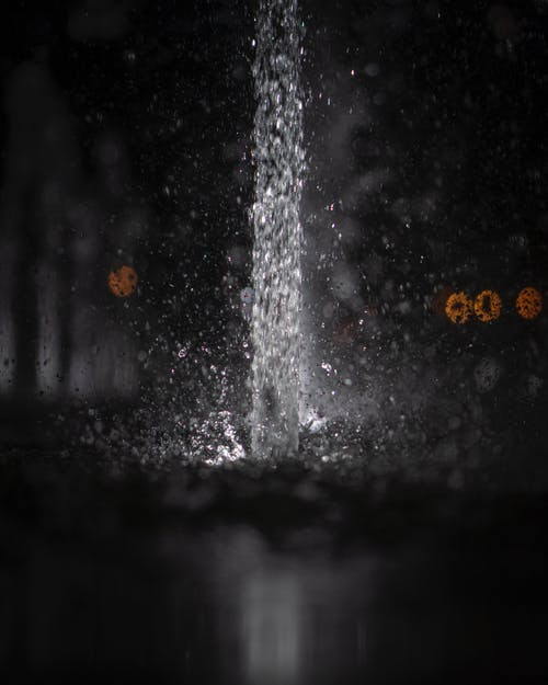 Water pouring and splashing in darkness