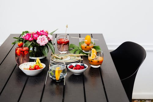 Fruits on White Ceramic Bowl on Brown Wooden Table