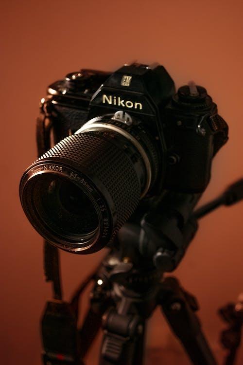 Photo camera on tripod in studio