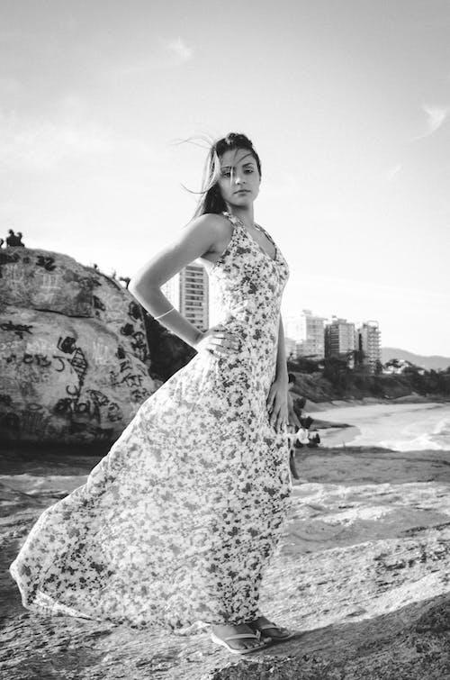 Elegant woman standing on seashore